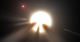 26nov2015---ilustracao-mostra-uma-estrela-atras-de-um-cometa-fragmentado-observacoes-sugerem-que-esse-seja-o-motivo-dos-misteriosos-padroes-de-luz-da-estrela-kic-8462852-1448536864426_615x300